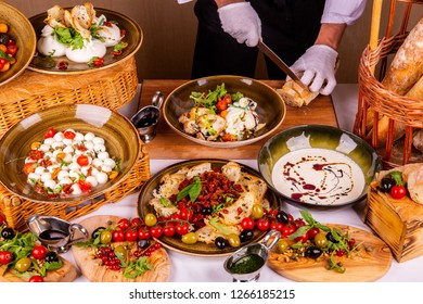 Olives, tomatoes, cheese, bread, greens, sauce and red currant
