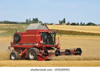 olivet, France - 13 mars 2021 : harvesting cereals using mechanical devices