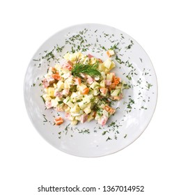 Olivier salad on a plate, isolated on white background. Top view