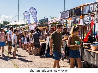 OLIVOS, ARGENTINA - March 25, 2016: People at a street food market festival on a sunny day