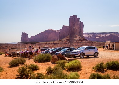 Oljato-Monument Valley, Arizona / USA - June 28 2017: tourist cars on a dusty dirt road in the Monument Valley, Utah. Summer trip to the landmarks of the Wild West USA. Navajo tribal park
