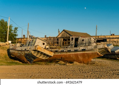 OLKHON, RUSSIA - JUNE 24, 2016: Abandoned boats of fish processing plant on the island in the center of Lake Baikal
