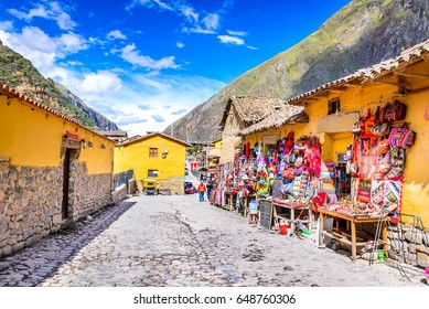 OLLANTAYTAMBO, PERU - 27 APRIL 2017: Downtown of the small medieval city of Ollantaytambo, with Inca ruins on Andes Mountains.