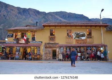 OLLANTAYTAMBO / PERU, August 15, 2018 : Tourists enjoy restaurants off the main square in Ollantaytambo