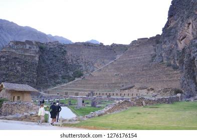OLLANTAYTAMBO / PERU, August 15, 2018 : Tourists enter the ruins of Ollantaytambo