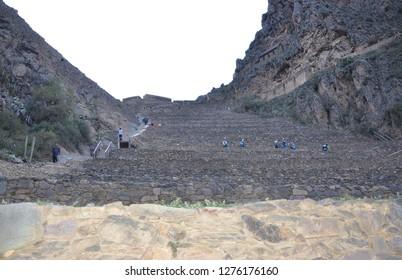 OLLANTAYTAMBO / PERU, August 15, 2018 : Tourists explore the ruins of Ollantaytambo