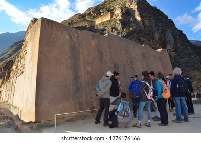 OLLANTAYTAMBO / PERU, August 15, 2018 : A guide explains the ruins of Ollantaytambo to tourists