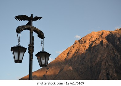 OLLANTAYTAMBO / PERU, August 15, 2018 : The condor, puma, and snake on this lamp in downtown Ollantaytambo represent the sky, earth and underworld in Inca tradition.