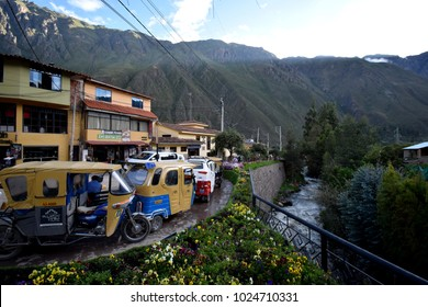Ollantaytambo, Peru - January 3rd, 2018   A rickshaw stop in the beautiful valley of Ollantaytambo, Peru, with massive green mountains in the background, next to a flowing river