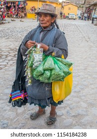 Ollantaytambo, Peru - May 20, 2016: Woman selling coca leaves and other coca product on  the market