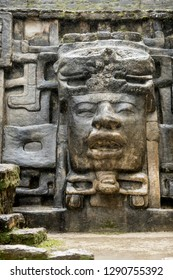 The Olmec style mask on the side of the Mayan temple of Lamanai in Belize.