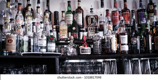 Olney, MD - December 3, 2017: A bar filled with many different types of alcohol, including varieties of hard liquor such as vodka, tequila, whiskey and rum.