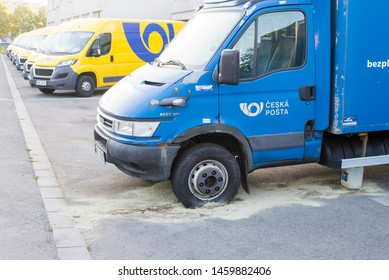 Olomouc Czech Rep 24th July 2019 Czech Post Office car with leaked diesel from a breatched tank. Old rusty Iveco daily with modern yellow vans in background. esk Po ta.