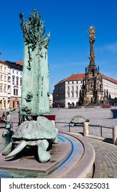 OLOMOUC, CZECH REPUBLIC - MAY 10, 2013: Arion fountain, The Trinity column (UNESCO), Upper square, Olomouc, Czech republic