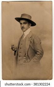 OLOMOUC, THE CZECHOSLOVAK REPUBLIC - CIRCA 1920s: Vintatge photo shows dandy man with cigarette and hat. Antique black & white photo.