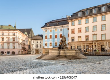 Olomouc old town with Caesar's Fountain and  historical buildings on Horni Namesti (Upper Square in Czech) in the morning