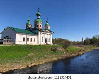 Olonets, Republic of Karelia, Russia. View of river Olonka, Orthodox Church and city park