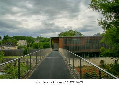 Oloron-Sainte-Marie/France; 06/16/2016. Passage over Ossau river to Médiathèque Intercommunale du Piémont (English: Mediatheque Intercommunale of Piedmont) in Oloron.