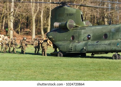 Olst Feb 7 2018: Amry and Air Force helicopter exercise. Chinook landing to pick up soldiers