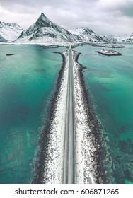 Olstind Mount and bridge, vertical panoramic shot, aerial view. Lofoten islands, Norway. Aerial View