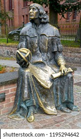 OLSZTYN, POLAND - AUGUST 26, 2018: A monument to Nicolaus Copernicus with an astrolabe in a hand