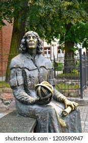 OLSZTYN, POLAND - AUGUST 26, 2018: A fragment of a monument to Nicolaus Copernicus with an astrolabe and the manuscript in hands