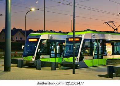 "OLSZTYN, POLAND - OCTOBER 14, 2018 - Evening view of Solaris Tramino trams standing at the ""Kanta"" terminus of the Olsztyn tramway network"