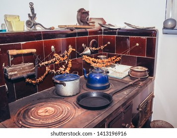 Olsztynek, Poland - August 19, 2010: Kitchen with antique tiled stove in traditional cottage in heritage park in Olsztynek town, Warmia-Mazury Province