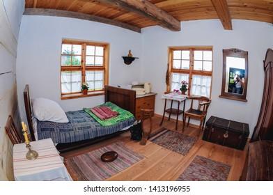 Olsztynek, Poland - August 19, 2010: Interior of traditional wooden cottage in heritage park in Olsztynek town of Olsztyn County in Warmia-Mazury Province
