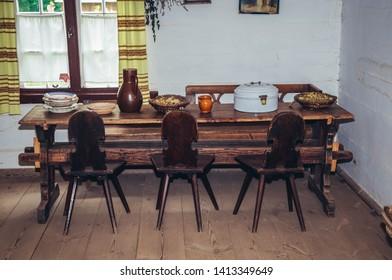 Olsztynek, Poland - August 19, 2010: Old wooden dining table in traditional wooden cottage in heritage park in Olsztynek town of Olsztyn County in Warmia-Mazury Province