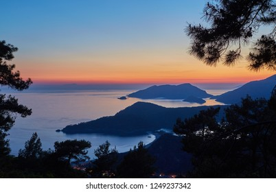 Oludeniz beach and small town of Oludeniz, view from mountain at sunset. Turkey