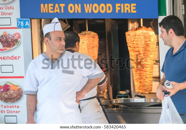 Oludeniz, Turkey, April 28, 2016: Chef cooking meat on skewer
