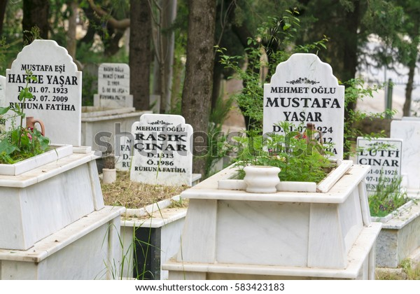 Oludeniz, Turkey, April 28, 2016: Muslim cemetery with white tombstones, background