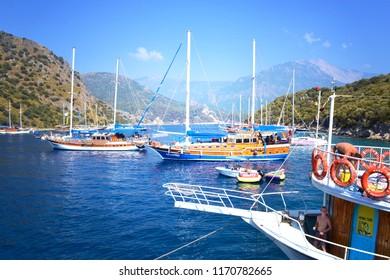 OLUDENIZ, TURKEY - September 2014: Excursion ships and islands in front of azure water of the Mediterranean sea, Oludeniz, Turkey