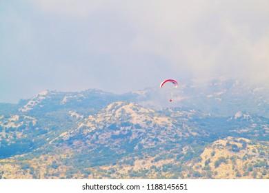 OLUDENIZ, TURKEY - September 2014: Paragliding in Oludeniz, Turkey
