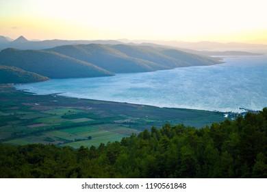 OLUDENIZ, TURKEY - September 2014: The sea view of the lagoon at sunset near Oludeniz, Turkey