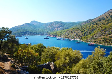 OLUDENIZ, TURKEY - September 2014: Yachts and and lagoon with azure water in the Mediterranean sea, Oludeniz, Turkey