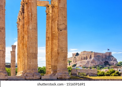 Olympian Zeus temple in summer, Athens, Greece. It is one of top landmarks of Athens. Great columns of the famous Zeus house overlooking Acropolis of Athens. View of majestic Ancient Greek ruins.