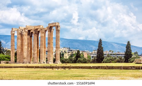 Olympian Zeus temple in summer, Athens, Greece. Ancient Greek Olympieion is one of top landmarks of Athens. Panoramic view of Columns of famous Zeus structure in summer. Landscape of old Athens city.