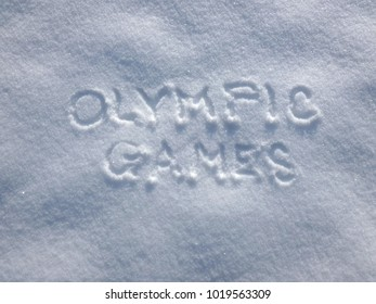 Olympic Games - Snow Write. Caption written on the snow surface. Frosty and sunny day.