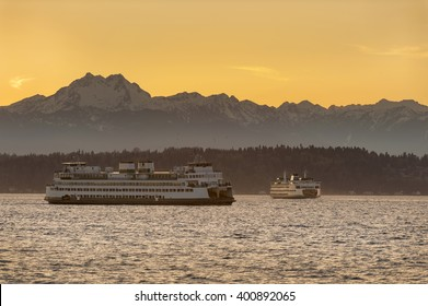 The Olympic Mountains and Ferry Boats. Commuters and tourists travel from the Olympic peninsula to downtown Seattle via ferry boats during a lovely springtime sunset.