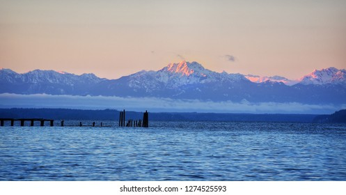 Olympic Mountains, Washington, at sunset covered in snow