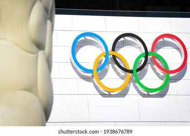The Olympic rings are seen above the entrance on the facade of the Olympic Museum in Lausanne, Switzerland on March 18, 2021