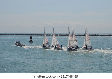 Olympic speed class sailboats being towed to the starting area on Biscayne Bay for the 49er,49erFX,Nacra17 midwinter regatta in Miami,Florida noon 16 February 2019