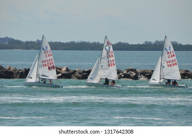 Olympic  speed  class sailboats being towed to the starting area on Biscayne Bay for the 49er,49erFX,Nacra 17 Midwinter Regatta in Miami,Florida on 16 February 2019