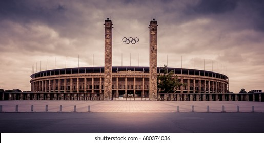 Olympic stadium Berlin - BERLIN, GERMANY  (May 2014). Exterior view a cloudy  day at famous and historic  Olympic Stadium in Berlin. Founded by Adolf Hitler, made by Werner March.