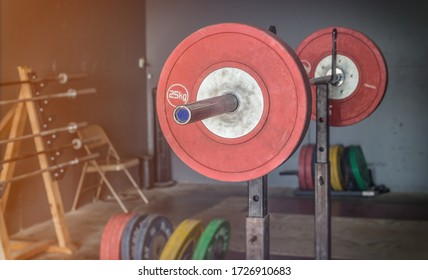 An olympic style weightlifting platform with weights on a bar.