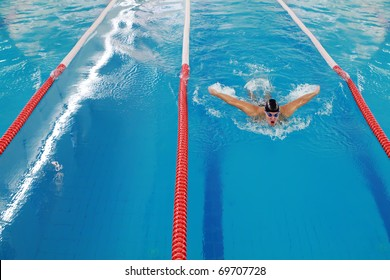 Olympic swimmer during butterfly stroke training in indoor swimming pool.  All the pictures in this series are of Vladan Markovic, Serbian butterfly champion and 4 times olympic swimmer: