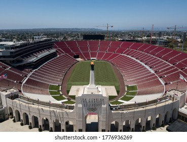 The Olympic torch at the Los Angeles Memorial Coliseum is lit to mark the 60th anniversary of John F. Kennedy's acceptance of the Democratic nomination for president, July 15, 2020 in Los Angeles.