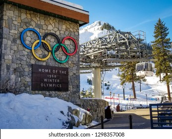 OLYMPIC VALLEY, CA/U.S.A. - JANUARY 23, 2019:  A photo of a resort sign with Olympic rings in the base area, and chairlift in the background.